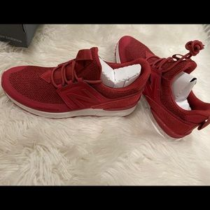 Red new balance mid top sneakers